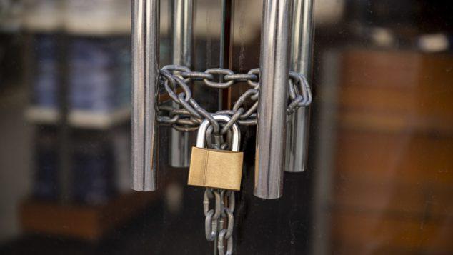 padlocked shop doors, non-payment rent concept